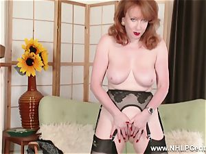 big-chested red finger humps cunt in garter nylons and pumps
