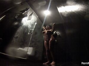 Romi washes off her flawless assets in the douche