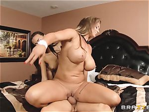 Eva Notty demonstrates her stepdaughter Janice Griffith how to please a chisel